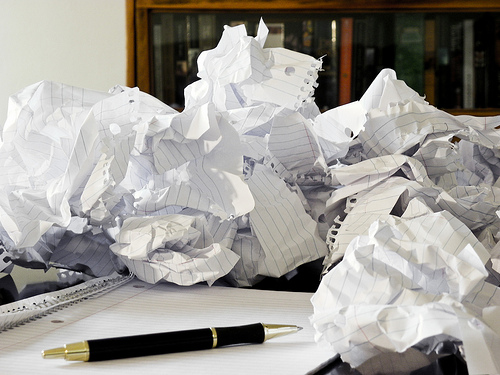 Crumpled paper and a pen